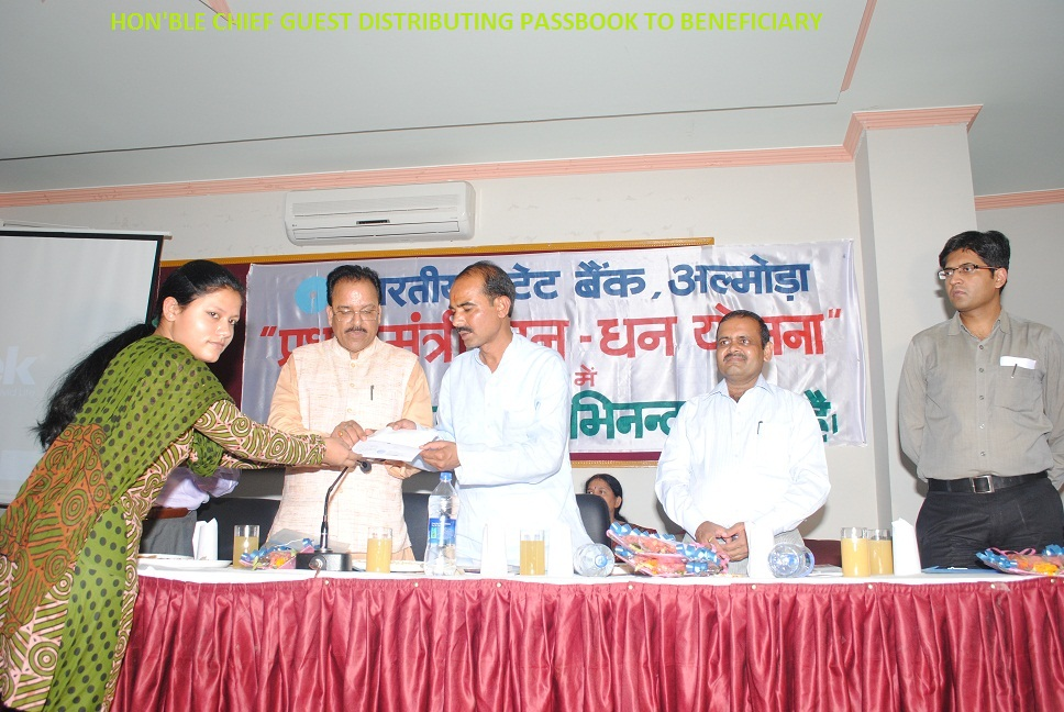Hon'ble Chief Guest Distributing Passbook To Beneficiary
